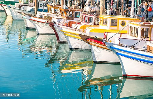 Colorful sailing boats at Fisherman's Wharf of San Francisco Bay - California - United States