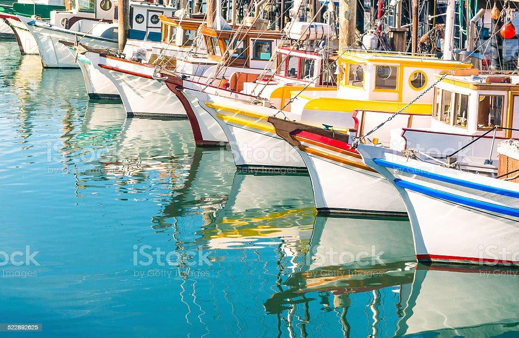 Colorful sailing boats at Fishermans Wharf of San Francisco Bay stock photo