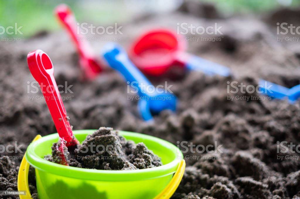 colorful sand box toys for kids in sand box, kids and baby concept.
