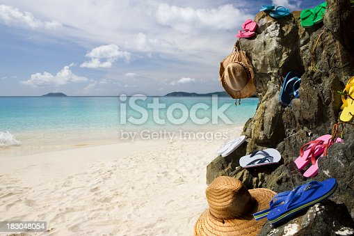 istock colorful sandals and summer hats on the Caribbean beach 183048054