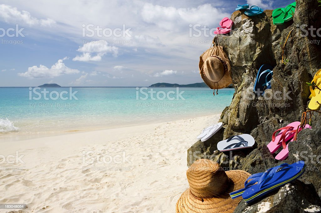 colorful sandals and summer hats on the Caribbean beach stock photo