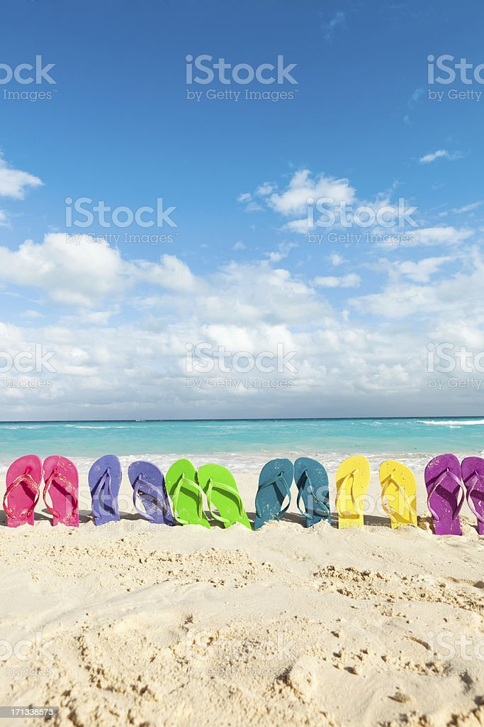 Colorful Sandals Party on Tropical Beach Vacation Vt stock photo