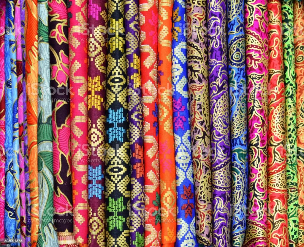 Colorful sarongs for sale at the art and craft market of Ubud Bali Indonesia stock photo