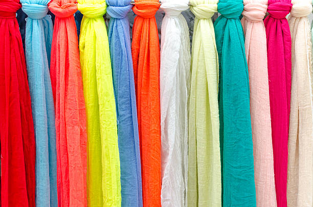 Colorful scarves at a market in Italy. Colors of textiles stock photo