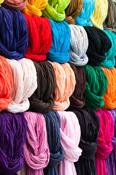 colorful scarves in a french shop - carolinemaryan stock pictures, royalty-free photos & images