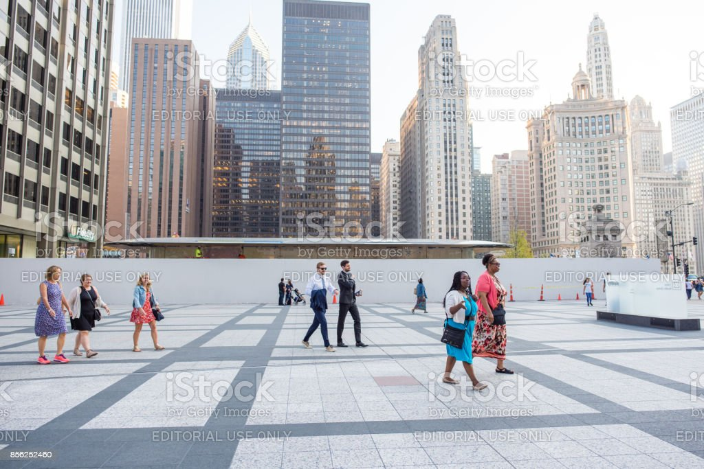 Colorful scene of people crossing Tribune Plaza downtown Chicago stock photo