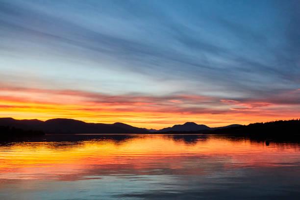 Colorful scenic sunset view of Loch lomond lake in Scotland, United Kingdom. stock photo