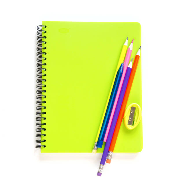 Colorful school supplies, books and pencil on white. Top view, flat lay. Square image. Colorful school supplies, books and pencil on white. Top view, flat lay. Square image. Copy space. workbook stock pictures, royalty-free photos & images