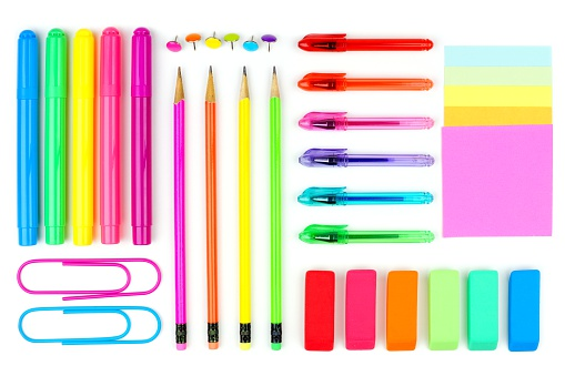 Colorful set of school supplies arranged as a flat lay on a white background