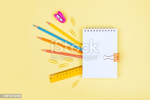 istock colorful school supplies on yellow background 1061815256