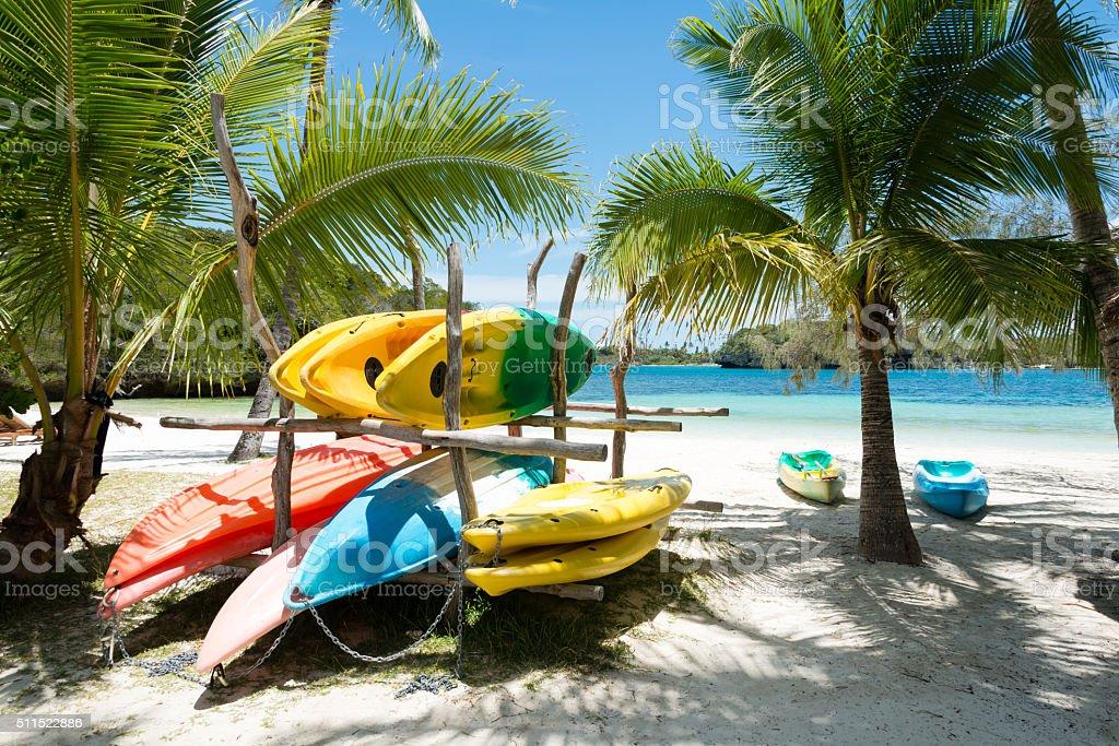 Colorful sea kayaks on the beach stock photo