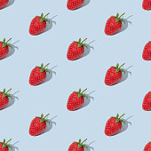Colorful seamless pattern made of red strawberries on blue background