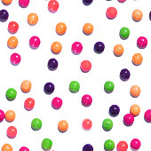 Colorful seamless texture pattern of multi colored sweet candy dragees. Round Bonbons scattered on a white background. Decorative Holiday Web banner. Beautiful Festive Wallpaper.
