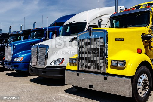 Indianapolis - Circa June 2018: Colorful Semi Tractor Trailer Trucks Lined up for Sale I