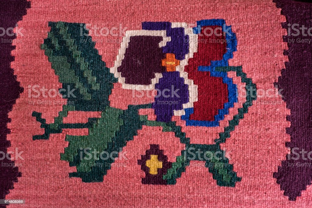 Colorful Serbian style rug surface and handmade carpet stock photo