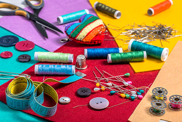 colorful sewing kit on a colored felt. - nähkits stock-fotos und bilder