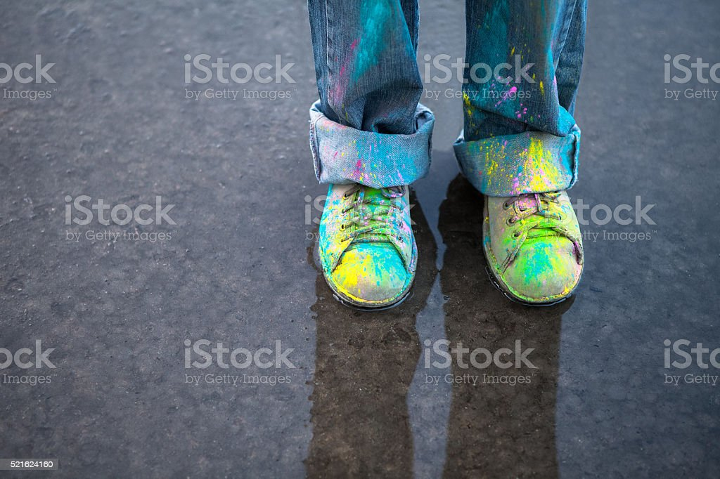 Colorful shoes on puddle stock photo