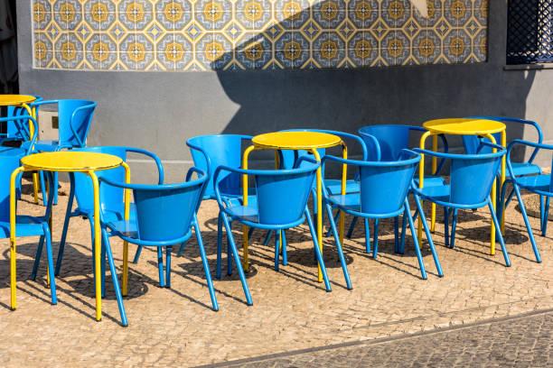 colorful sidewalk cafe in aveiro, portugal. - esplanada portugal imagens e fotografias de stock