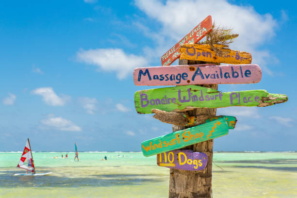 Colorful signpost at coast of Bonaire stock photo
