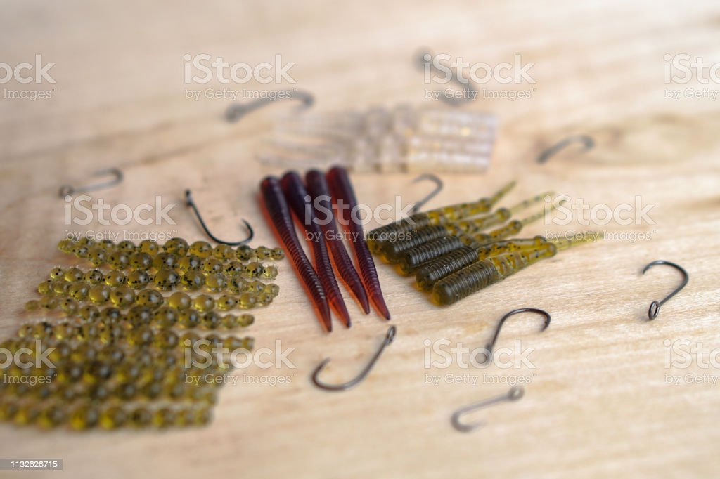 Colorful Silicone Fishing Baits With Plummets On Wooden