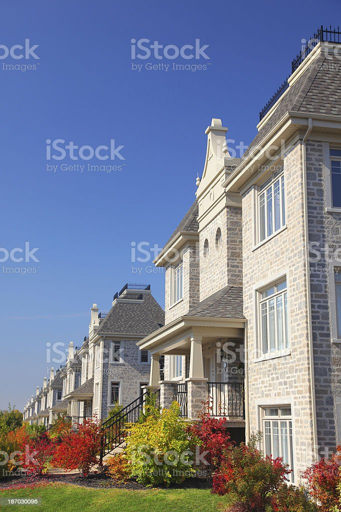 Colorful Similar Condominium Buildings with Plants royalty-free stock photo