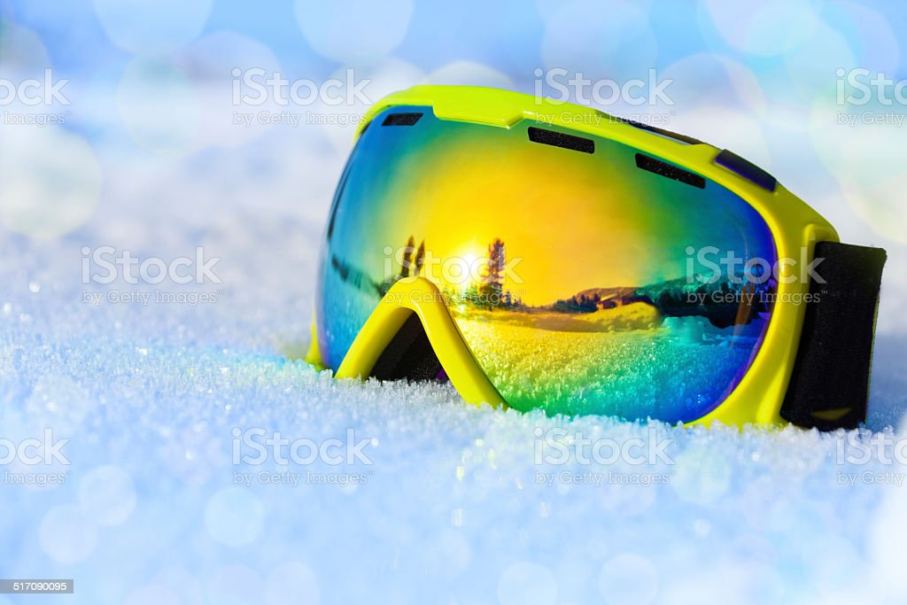 Colorful ski mask on white icy snow stock photo