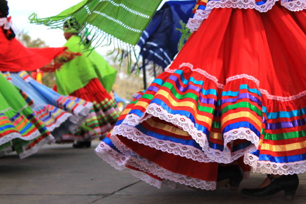 Colorful skirts fly during traditional Mexican dancing Close up of colorful skirts flying during traditional Mexican dancing. Young girls perform on a stage during an event celebrating Latino culture and heritage. latin american culture stock pictures, royalty-free photos & images