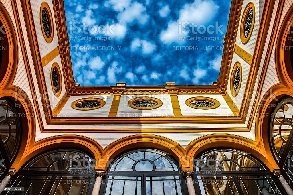 Colorful sky contrasted with ancient Moorish architecture stock photo