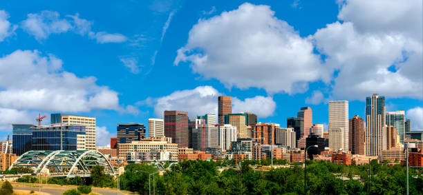 Colorful skyline of Denver Colorado with clouds in the sky Tall skyscrapers of the Denver Colorado skyline in the afternoon denver stock pictures, royalty-free photos & images