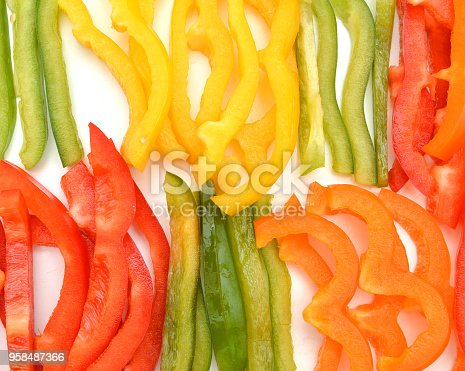 Colorful sliced bell peppers closeup