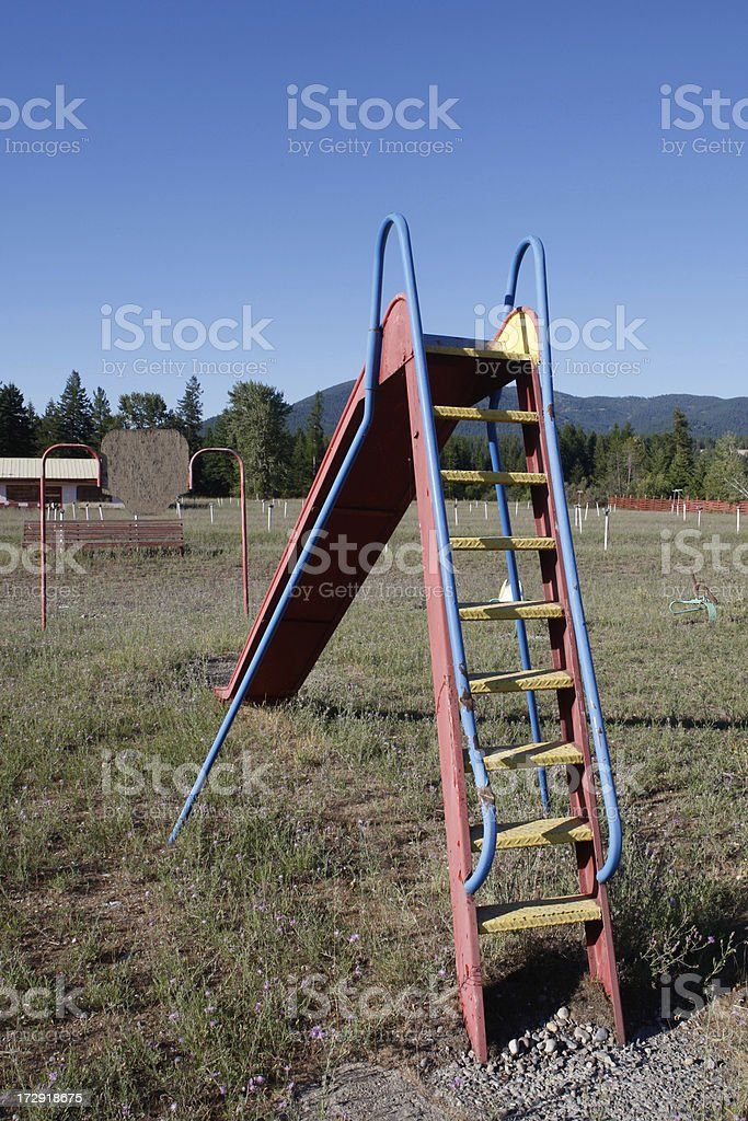 Colorful Slide at Abandoned Drive In royalty-free stock photo