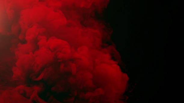 colorful smoke on black background stock photo