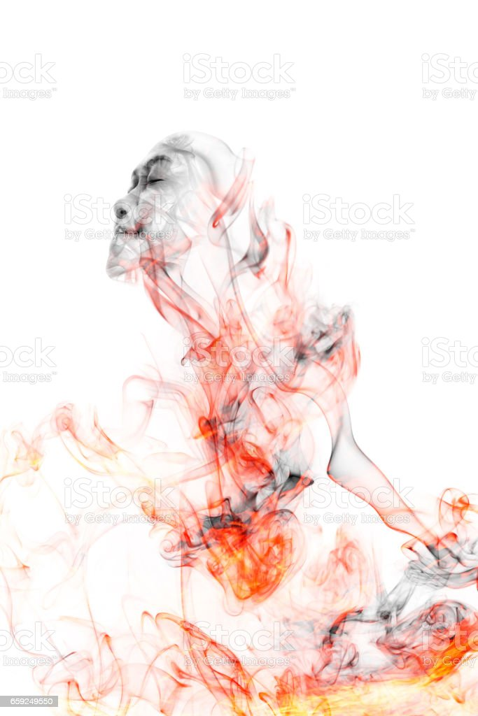 Colorful smoke that resembles a woman's face. stock photo