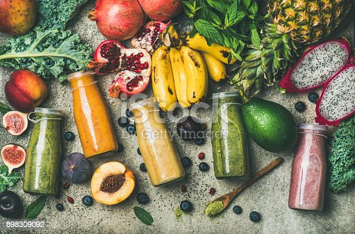 istock Colorful smoothies in bottles with fresh tropical fruit and superfoods 898309092