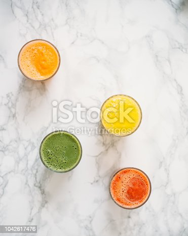 Colorful smoothies in glass with fresh tropical fruit and superfoods