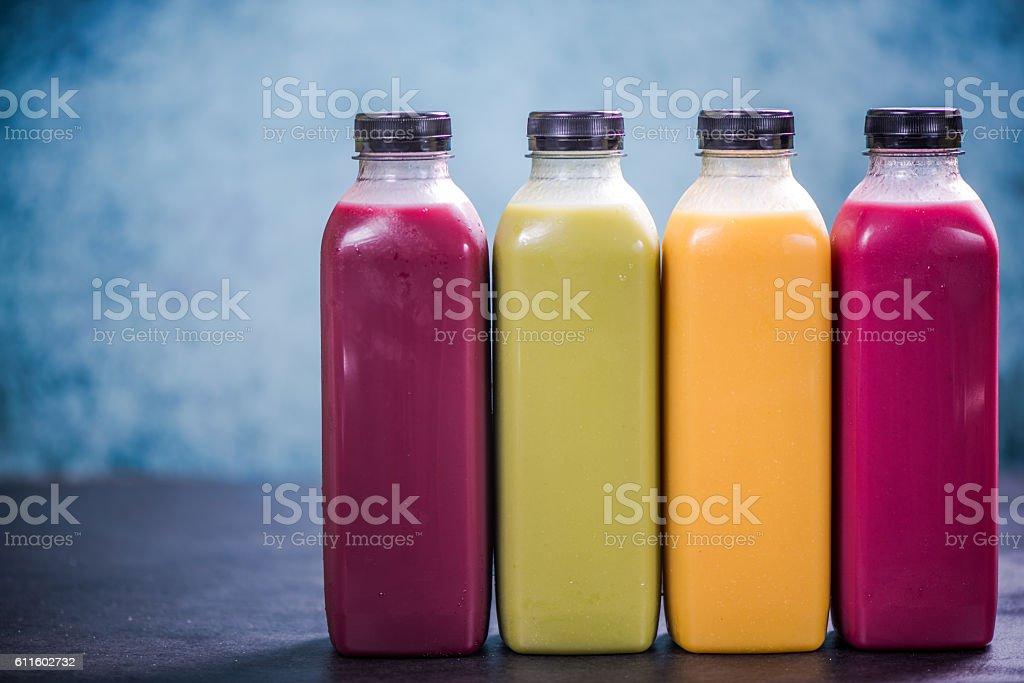 Colorful smoothies in plastic bottles stock photo