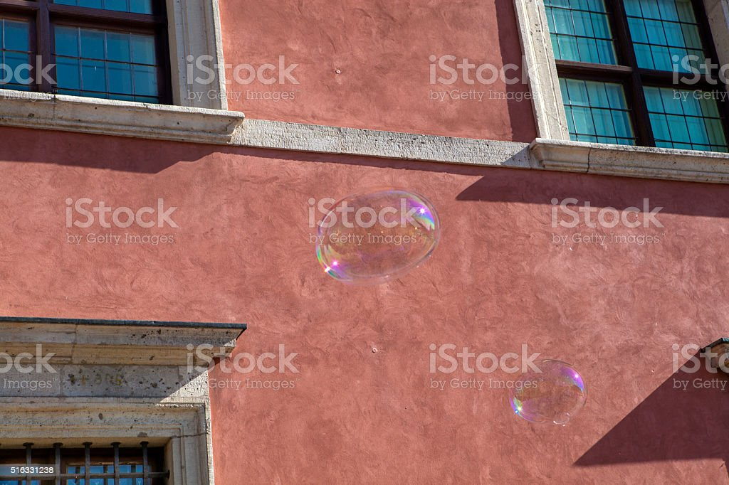 Colorful soap bubbles on a city street stock photo
