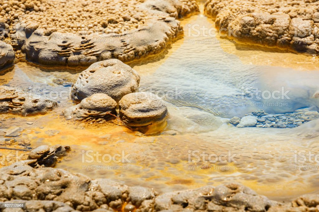Colorful soil, blue water of hot springs, geysers. Mineral deposits. Alien planet looking soil. Yellowstone National Park. USA stock photo