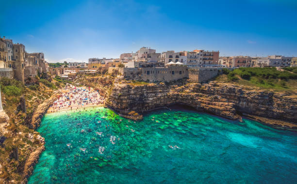 colorful south italy village in Puglia in the town of Polignano stock photo
