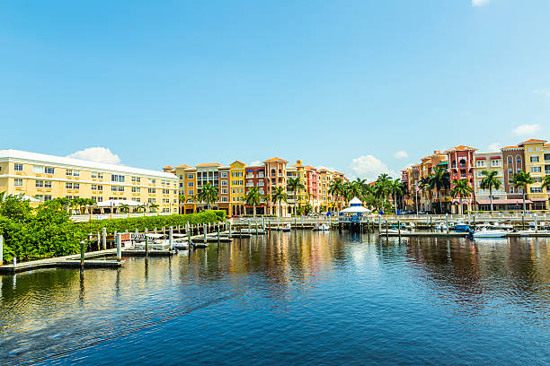 Colorful Spanish influenced buildings overlooking the water Colorful Spanish influenced buildings overlooking the water in tropical Naples Florida . naples florida stock pictures, royalty-free photos & images