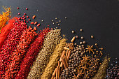 istock Colorful spice background for website  headers or food labels. Collection of herbs and herbs are scattered on black table. 1154886521