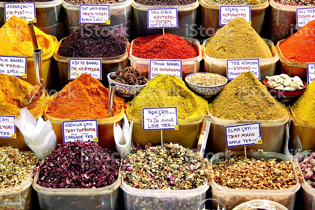 Colorful spice baskets on a market stand royalty-free stock photo