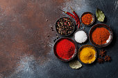 Colorful spices on stone table. Top view with space for your recipe