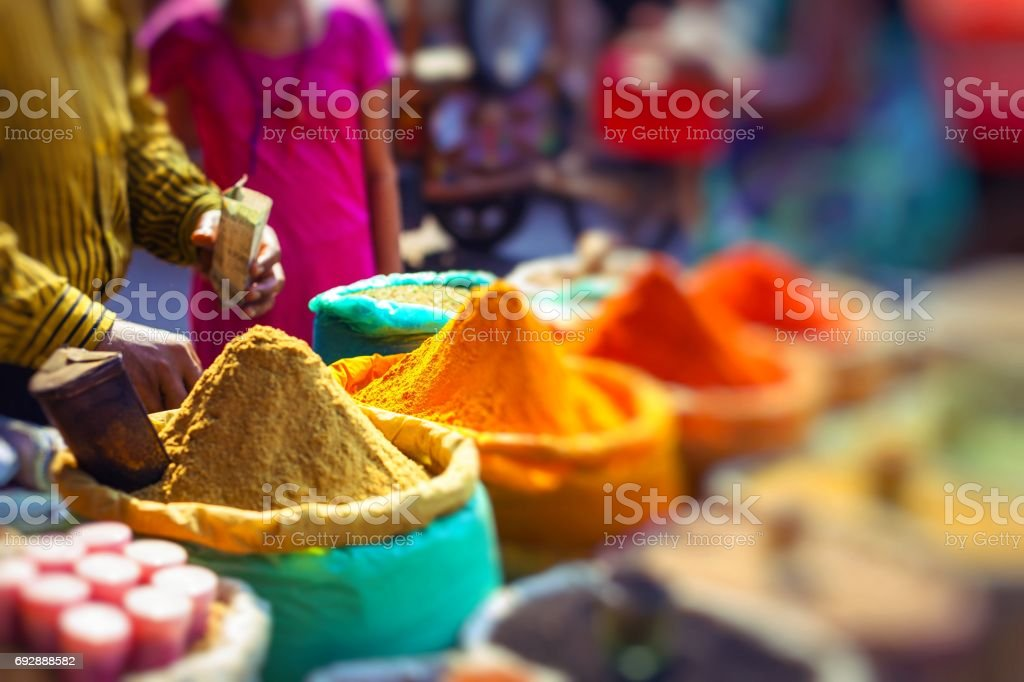 Colorful spices powders and herbs in traditional street market in Delhi. India. stock photo
