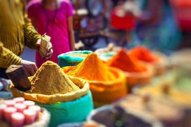 colorful spices powders and herbs in traditional street market in delhi. india. - india foto e immagini stock