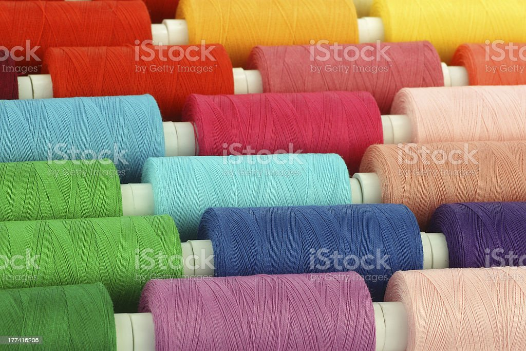 colorful spindles of yarn stock photo