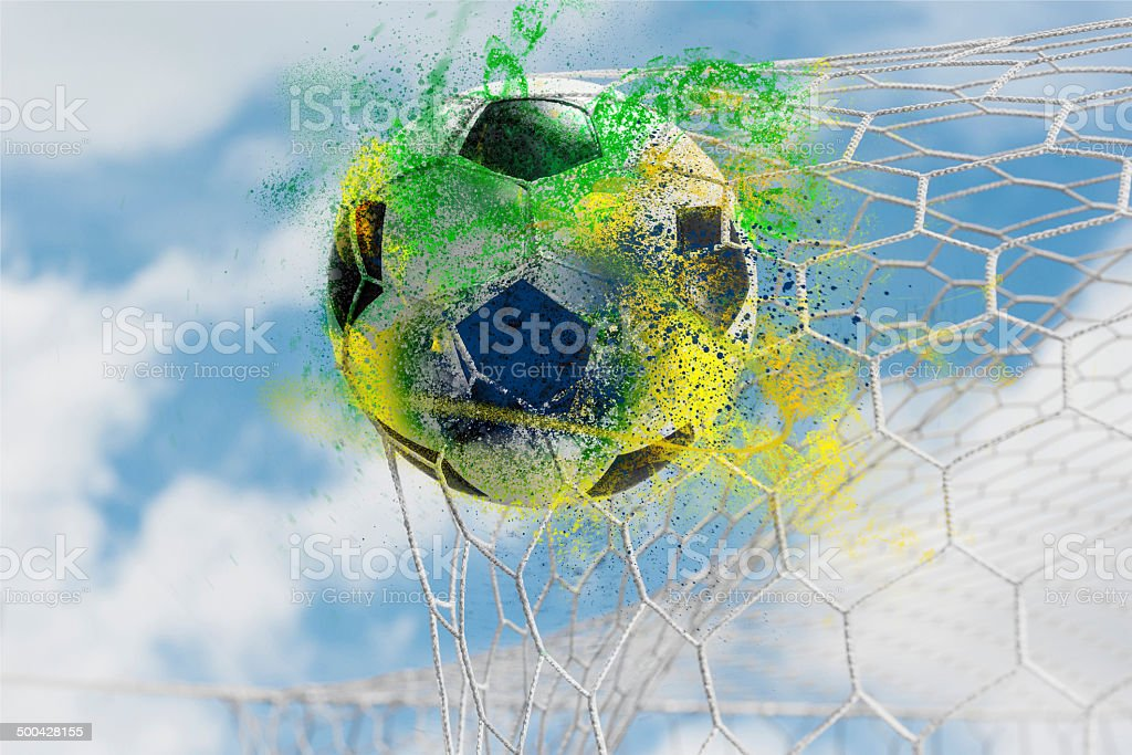 Colorful splash Soccer ball in goal, success concept royalty-free stock photo