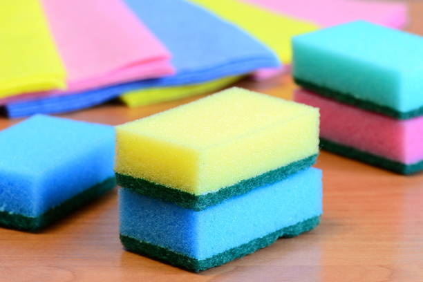 Colorful sponge and rags for cleaning ware and house cleaning stock photo