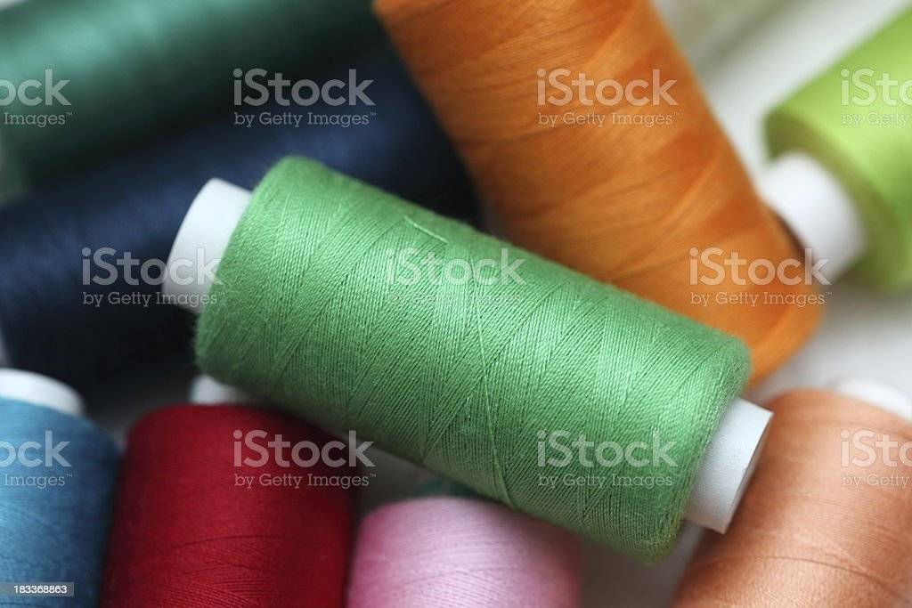 Colorful spools of sewing threads royalty-free stock photo