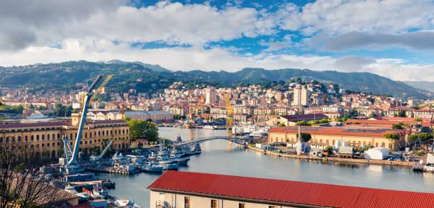 colorful spring view of port of la spezia city. sunny morning scene of mediterranean sea, liguria, italy, europe. magnificent mediterranean landscape. artistic style post processed photo. - la spezia foto e immagini stock